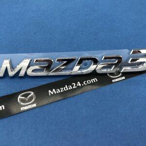 BHN951721 - 2014-2018 Mazda 3 hatchback trunk lid badge (model name)