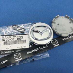 G22C37190A - Mazda center wheel cap silver