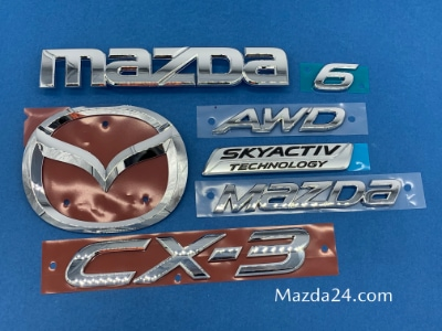 Genuine Mazda trunk lid emblems and nameplates